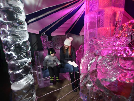 Nicole Sudol and son Aiden, 3, of Towaco hang out on the ice carousel at the Frozen in Ice Carnival at the Skylands Stadium in Frankford is an ice sculpture extravaganza featuring more than 100 tons of ice sculptures, food, and entertainment. February 18, 2017, Frankford Township, NJ.