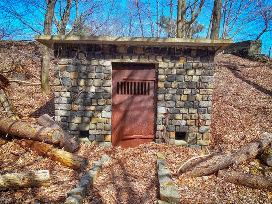 Just past a stone building, now used as a private residence, are two more old buildings seen along the bike path in Hook Mountain State Park. The first one resembles a stockade, although I have no idea what its purpose was.