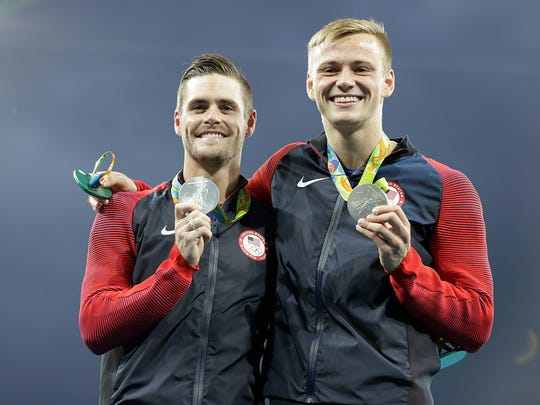 United States' silver medalists Steele Johnson, right, and David Boudia, left, pose with their medals after the men's synchronized 10-meter platform diving final in the Maria Lenk Aquatic Center at the 2016 Summer Olympics in Rio de Janeiro.