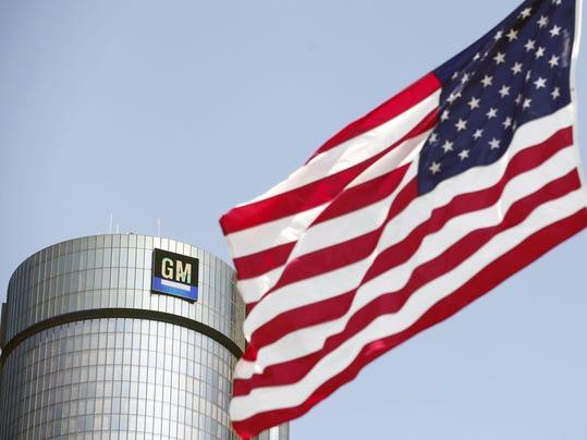 FILE: GM Doubles Profits