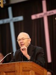 Bishop J. Douglas Deshotel addresses students during