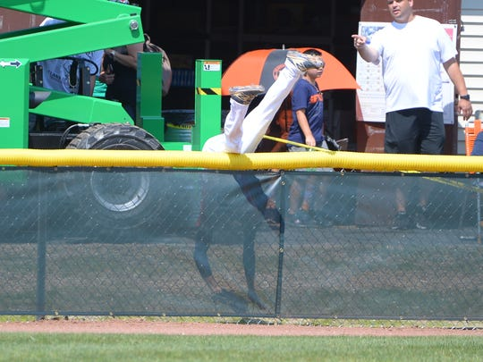 Jack Regenye catches himself on the ground and hangs onto the ball after making his amazing grab in the championship game Sunday.