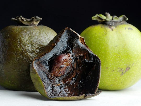 Ripe (left and opened) and unripe black sapote