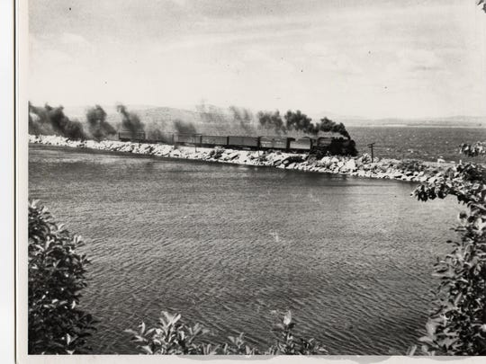 Smoke pours from a locomotive on the Colchester Causeway.