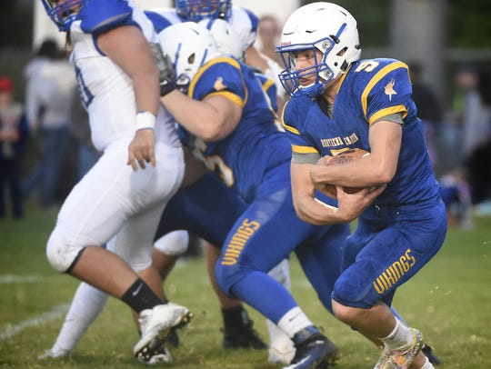 Northern Lebanon's Stevie Herb looks for running room