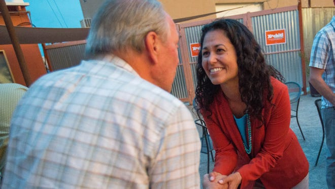Xóchitl Torres Small, shakes hands with David Brown as he congratulates her on her primary race win. Tuesday June 5, 2018, at Amaro Winery.