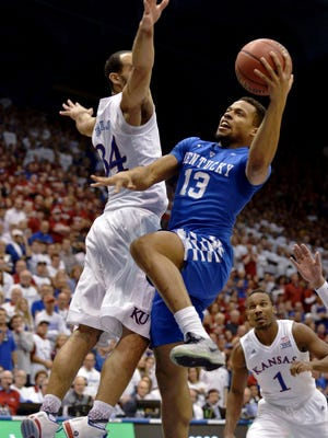 Jan 30, 2016; Lawrence, KS, USA; Kentucky Wildcats guard Isaiah Briscoe (13) shoots a layup as Kansas Jayhawks forward Perry Ellis (34) defends during the first half at Allen Fieldhouse.