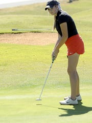 Stewarts Creek sophomore Katherine Harper follows her putt on the 18th green Wednesday at the Class AAA State Golf Tournament.