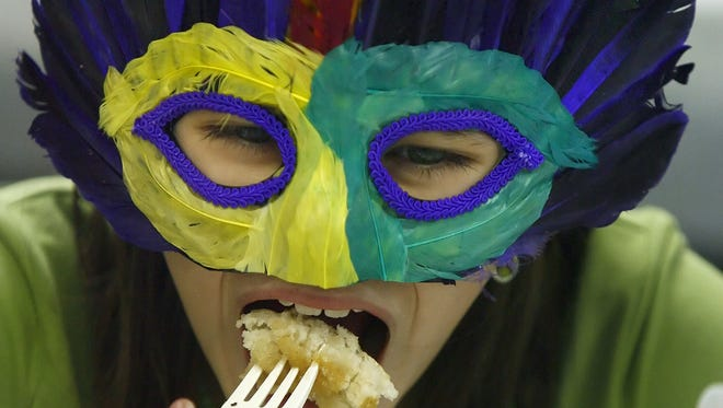 Priya Shields partakes in pancakes at a past Indy Mardi Gras celebration. Speedway kicks off the festival season this weekend with Mardi Gras on Main 6 p.m. to midnight Feb. 7.