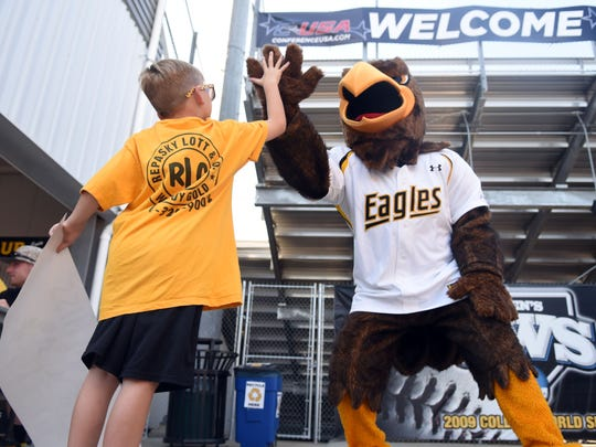 Art Alexander, 5, gives a high five to Seymour in May 2016 during the C-USA Baseball Championship Fan Fest at Pete Taylor Park.