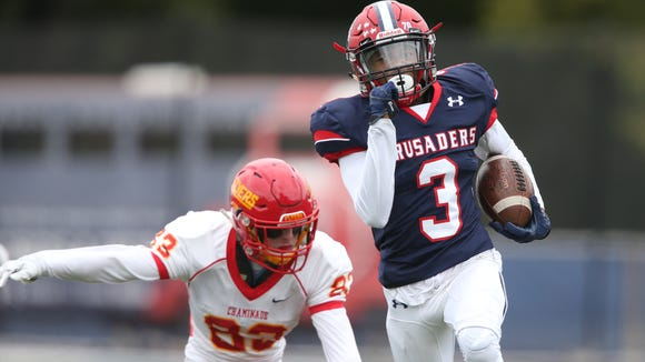 Stepinac's Shawn Harris (3) breaks free to score a