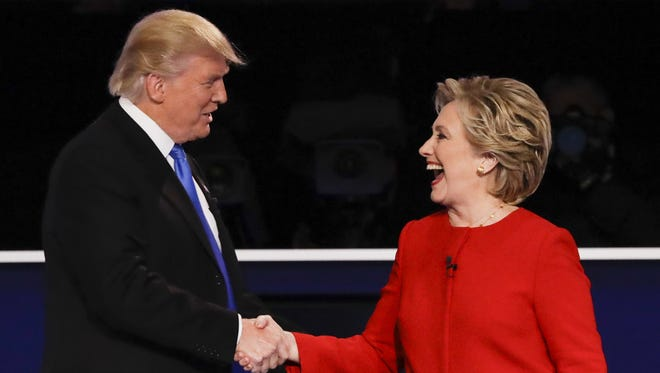 Republican presidential nominee Donald Trump shakes hands with Democratic presidential nominee Hillary Clinton after the presidential debate at Hofstra University in Hempstead, N.Y., Monday, Sept. 26, 2016. (AP Photo/David Goldman)