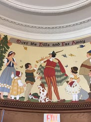 A mural of fairy tale and folk tale characters at the