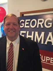 Republican Supervisor George Hoehmann announces that