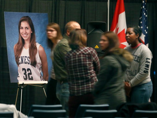 A photo of Kelsey Annese, 21, of Webster is on display