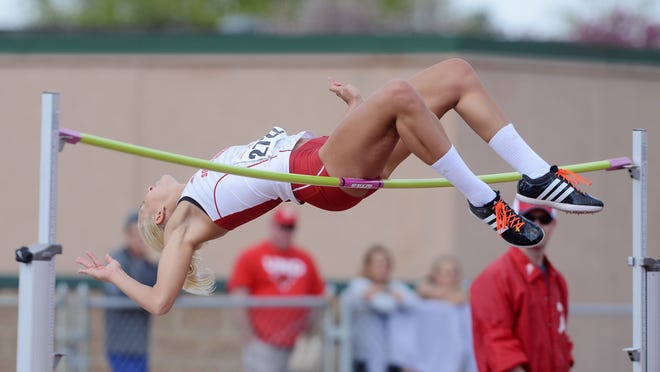 Megan Glisar brushes the high bar during a jump at Howard Wood Field in 2015. According to a recent study, South Dakota is home to the tallest women in the country.