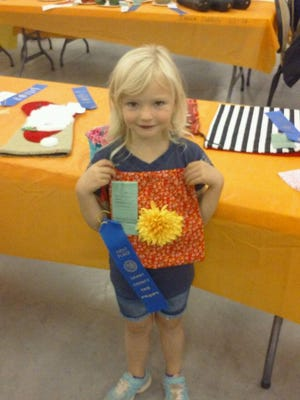 Five-year-old Brooklyn Bird shows off her award winning handiwork. She won first place in the sewing division on Thursday at the Grant County Fair. Brooklyn is a Kindergarten student at Cliff Elementary. The fair continues today and throughout the weekend in Cliff.