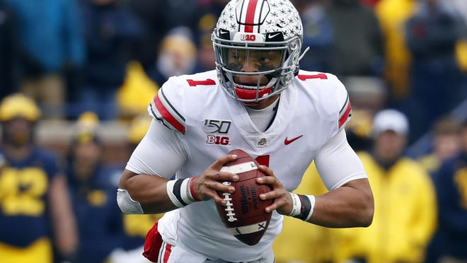 Ohio State quarterback Justin Fields led the Buckeyes to the Big Ten Conference title last year. The Buckeyes looked to be a national title contender this year with Fields back until the Big Ten canceled all fall sports on Tuesday.
