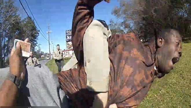 In this still image from body camera video released by the Valdosta police, Antonio Arnelo Smith is slammed face-first to the ground by a Valdosta police sergeant, in Valdosta, Ga., on Feb. 8, 2020. The video shows Smith handing his driver's license to a police officer and answering questions cooperatively before a second officer, Sgt. Billy Wheeler, approaches him from behind, wraps him in a bear hug and slams him face-first to the ground. Smith is crying in pain when he's told there's a warrant for his arrest. Officers are then told the warrant was for someone else.