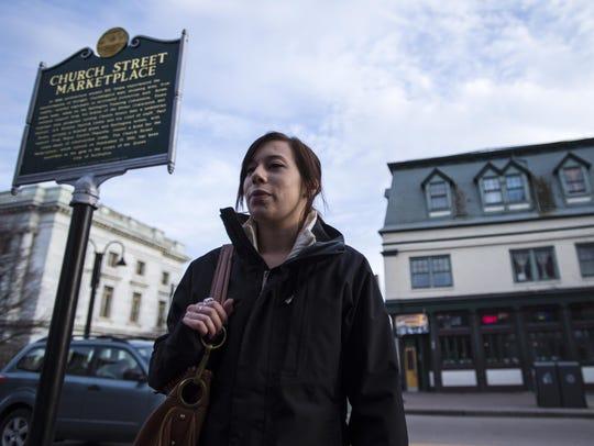 Shelby Bermani, 24, of Burlington, discusses her smoking