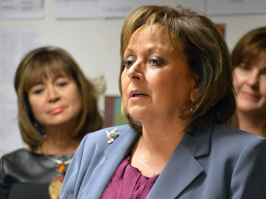 Gov. Susana Martinez talks to reporters at the Mission Achievement and Success Charter School in Albuquerque on Tuesday. The Republican governor called for further belt tightening by state government as she unveiled a budget proposal to close the state's general fund deficit and restore depleted reserves, while sticking with her vow to avoid tax increases.