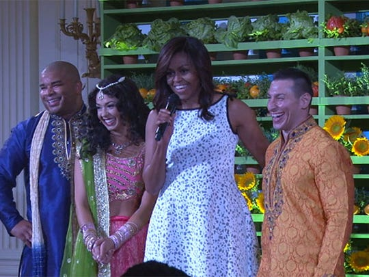"""First lady Michelle Obama with the cast of Disney's """"The Jungle Book,"""" wihich provided entertainment for the """"Kids' State Dinner"""" that is part of Mrs. Obama's """"Let's Move"""" initiative."""