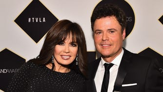 BEVERLY HILLS, CA - APRIL 11:  Singers Marie Osmond (L) and Donny Osmond pose backstage  with the Pop Culture Award during the 2015 TV Land Awards at Saban Theatre on April 11, 2015 in Beverly Hills, California.  (Photo by Alberto E. Rodriguez/Getty Images)