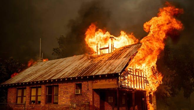 A historic schoolhouse burns as the Carr Fire tears through Shasta on Thursday.