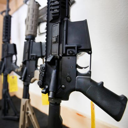AR-15 semi-automatic guns are on display for sale at