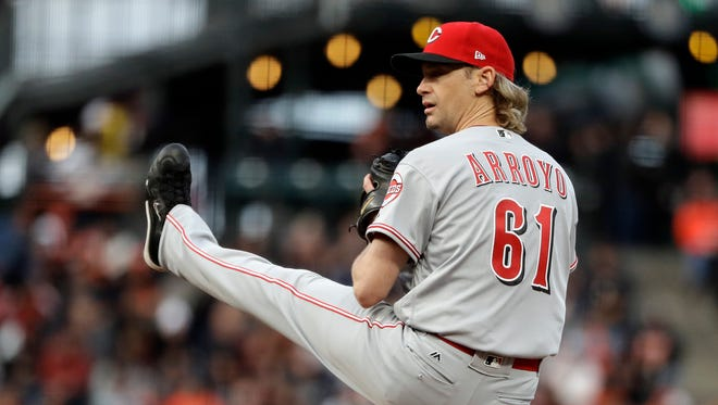 Cincinnati Reds starting pitcher Bronson Arroyo throws to the San Francisco Giants during the first inning Thursday.
