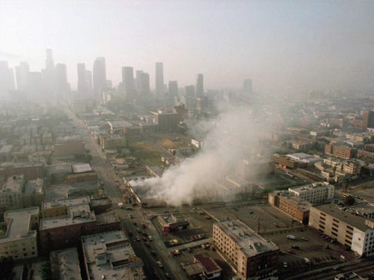 In this April 30, 1992 file photo, smoke rises from