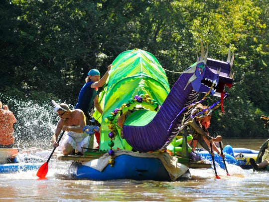 'Drag On' floats down the river during the Anything That Floats Parade on Saturday, August 13, 2016 at Hominey Creek Park in Asheville.