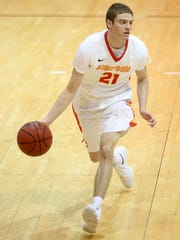 Simpson College's Conor Riordan brings the ball up