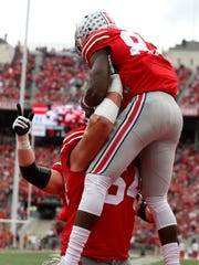 Ohio State guard Billy Price celebrates with Terry