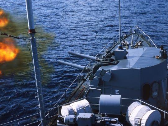 USS Gearing firing a double salvo.
