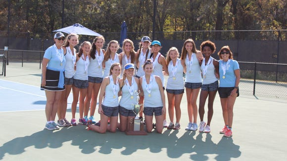 The Christ Church tennis team gathers after winning its 17th state championship.