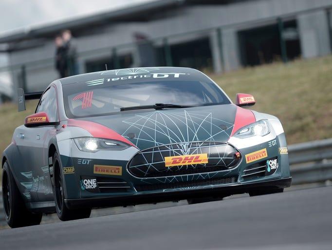 A Tesla Electric GT car drives on the Pau-Arnos circuit