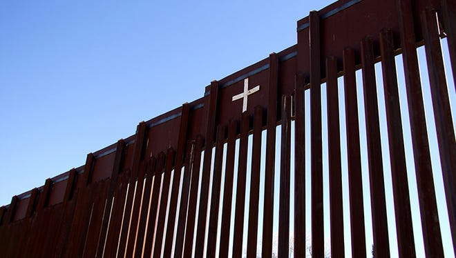 A general view a cross on the United States and Mexico border wall in Nogales on Jan. 25, 2017.