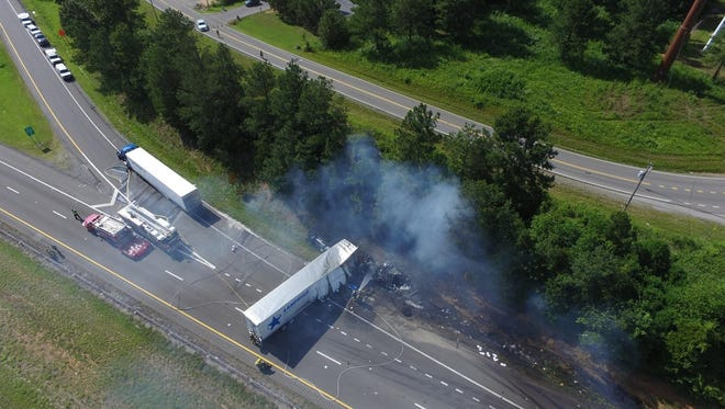 An aerial view of Friday's fatal wreck at the I-40 West exit 172 ramp that killed one motorist and injured four others, after a tractor-trailer hit another vehicle on the roadway shoulder.