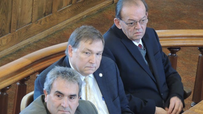 Douglas Every, far right, listens in Tioga County Court jurors convict him of first-degree manslaughter in the 2013 stabbing death of Milton Jump. Every is joined by his defense lawyers George Awad, left, and Tom Cline, center.
