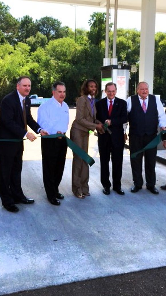 State officials cut the ribbon on the state's first LNG fueling station in  Pearl.