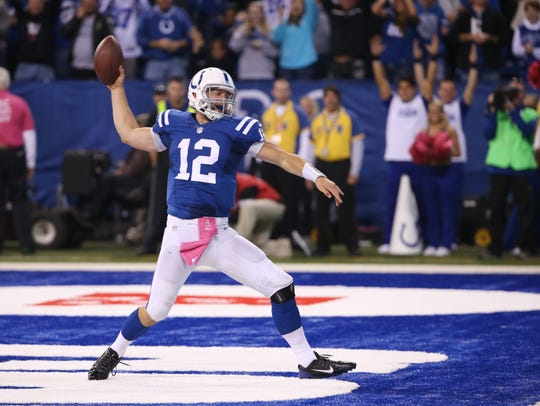 Indianapolis Colts quarterback Andrew Luck spikes the