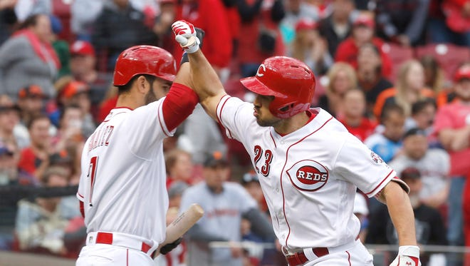 May 6, 2017; Cincinnati, OH, USA; Cincinnati Reds left fielder Adam Duvall (23) celebrates with third baseman Eugenio Suarez (7) after Duvall hit a solo home run against the San Francisco Giants during the first inning at Great American Ball Park. Mandatory Credit: David Kohl-USA TODAY Sports