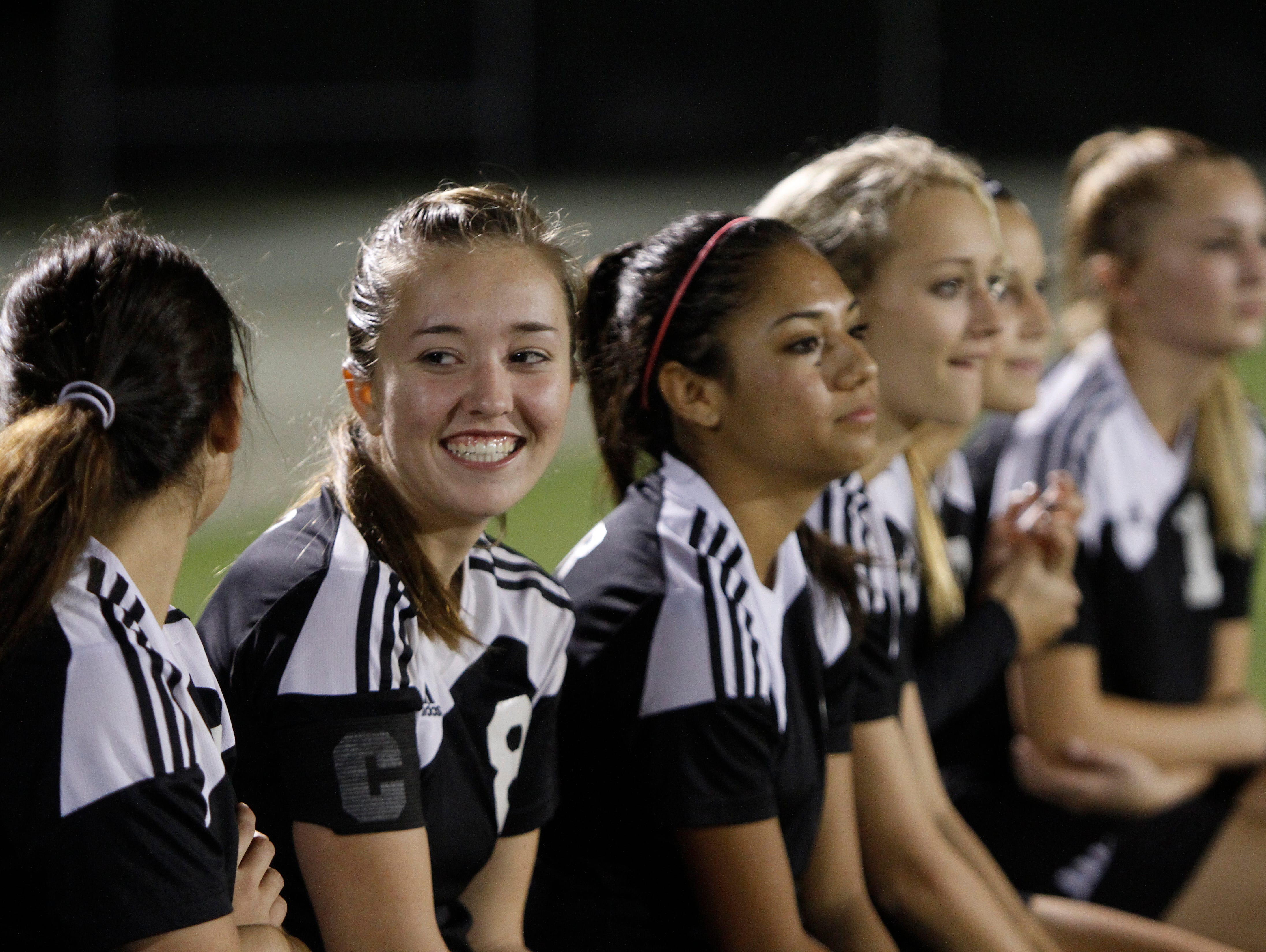 Mariner's Hannah Theirault , left, is all smiles after going up 7-0 against Lehigh Friday in Lehigh Acres.