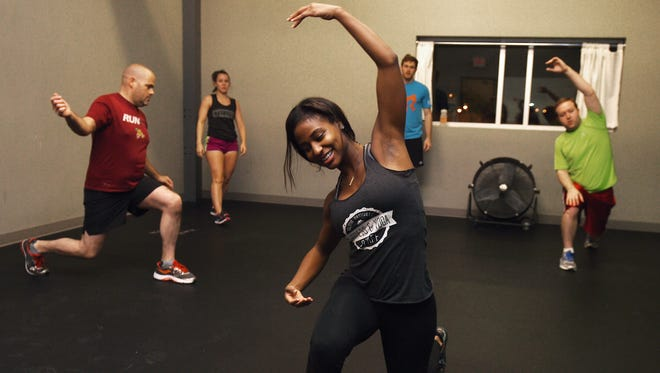 Staci Buford demonstrates an exercise during her Body Weight Burn class at Climb Nashville on Nov. 30.