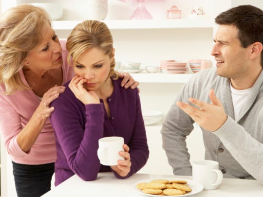 Senior mother pictured with son, daughter-in-law