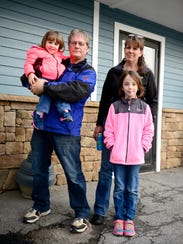 From left, Bill Donovan holds daughter Madison, 2,