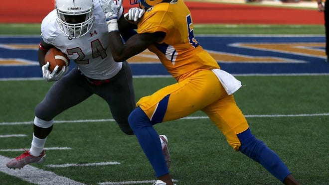 Adam Sauceda/Standard-Times ASU defender Levontre Edwards works to bring down a ball carrier earlier this season.