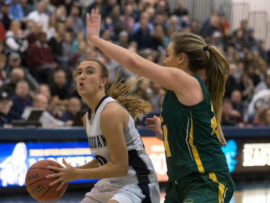 Manasquan's Dara Mabrey works in towards the basket