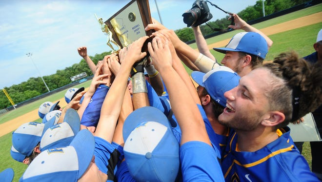 Pennsville players hoist the Group 1 championship trophy after defeating Waldwick 3-2 at Toms River East on Saturday. 6.11.16. J